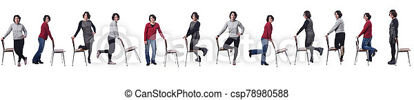 large group of woman playing with a chair in white background - csp78980588