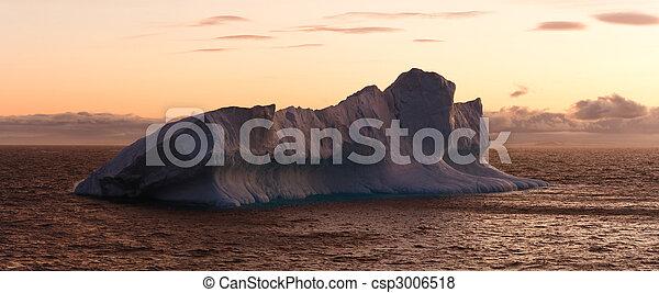 Large Iceberg Floating in Sea at Dusk - csp3006518