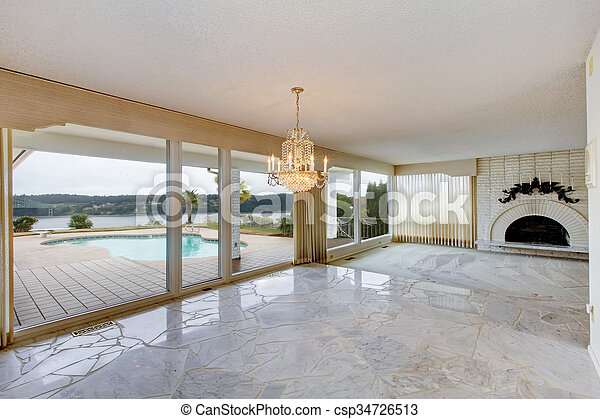 Superbe Large Luxury Empty Living Room With White Marble Floor, Large Windows, And  Fireplace.