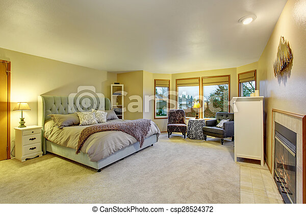 Large master bedroom with fireplace. - csp28524372