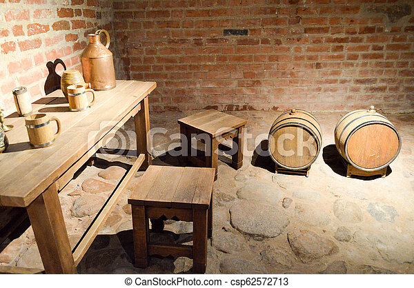 Large Round Wooden Barrels For Beer Wine In The Old Cellar Of The Middle Ages Made Of Brick