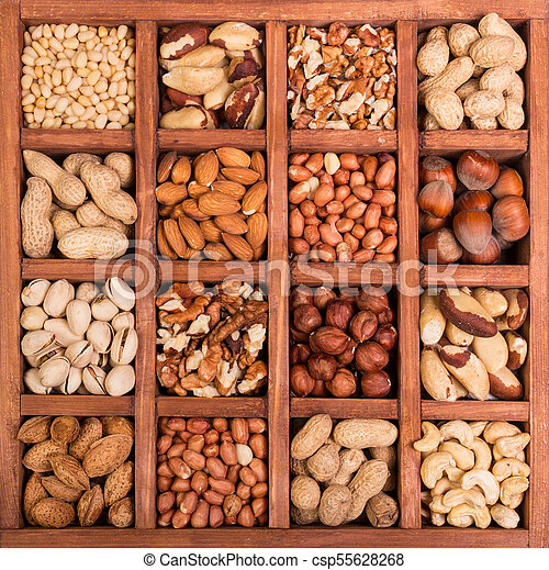 Large selection of peeled nuts, and kernels in shell, in wooden box with cells - csp55628268