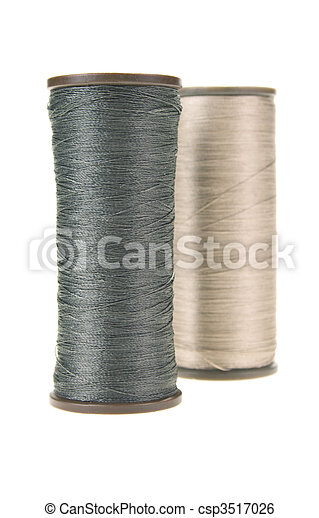 large spools of thread on a white background - csp3517026