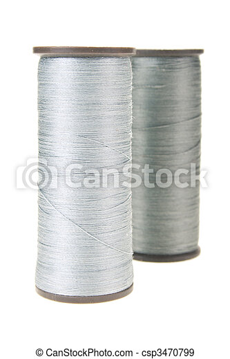 large spools of thread on a white background - csp3470799