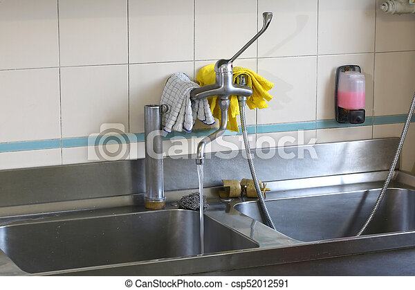 Large Stainless Steel Sink In An Industrial Kitchen