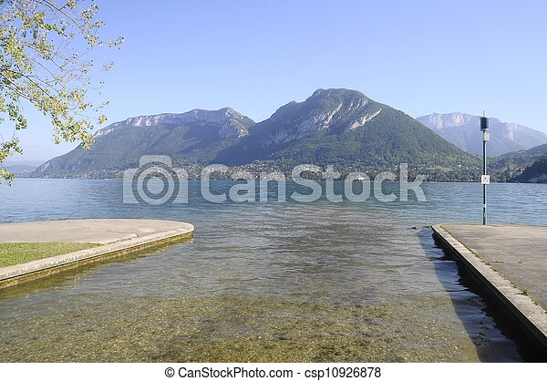 Large view of Annecy lake and mountains from Saint-Jorioz beach, France - csp10926878