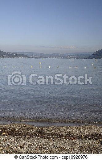Large view of Annecy lake and mountains from Saint-Jorioz beach, France - csp10926976