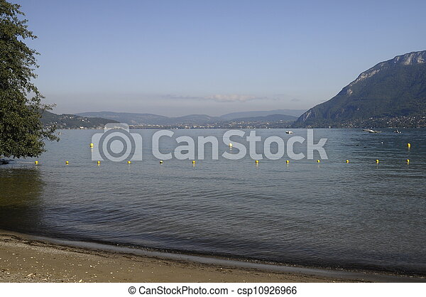Large view of Annecy lake and mountains from Saint-Jorioz beach, France - csp10926966