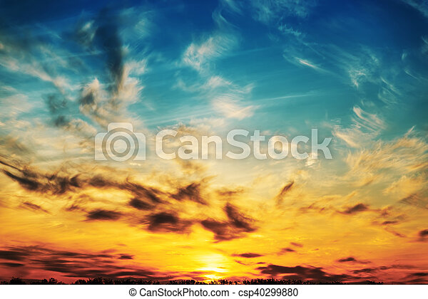 last rays of the sun in dramatic sky - csp40299880