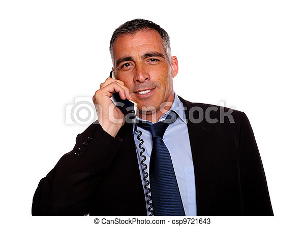Latin charismatic businessman smiling with a phone - csp9721643