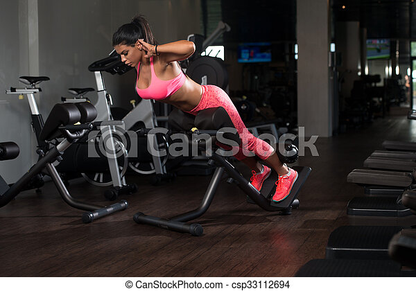 latina woman doing exercise for back young latina woman