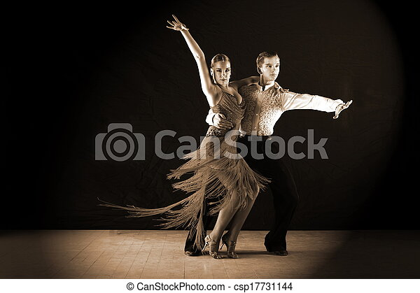 Latino dancers in ballroom against black background - csp17731144