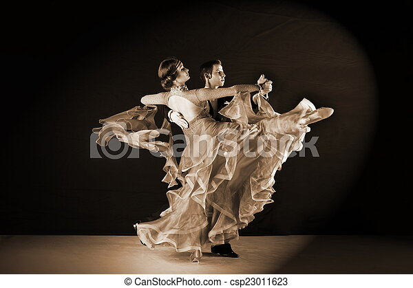 Latino dancers in ballroom against black background - csp23011623