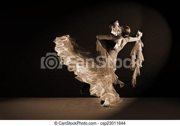 Latino dancers in ballroom against black background - csp23011644