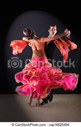 Latino dancers in ballroom against black background - csp16625494