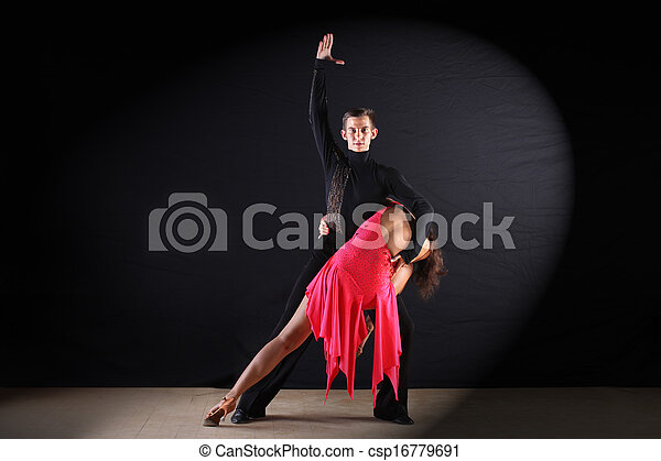 Latino dancers in ballroom against black background - csp16779691