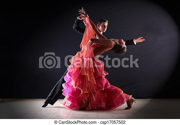 Latino dancers in ballroom against black background - csp17057502