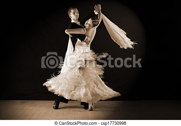 Latino dancers in ballroom against on black - csp17730998