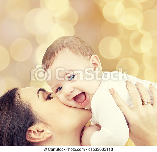 laughing baby playing with mother - csp33682118