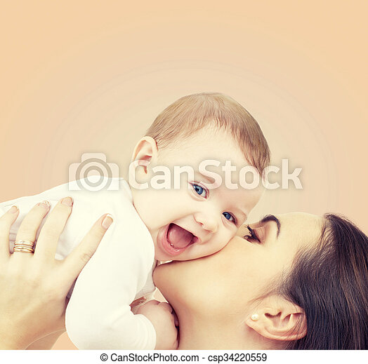 laughing baby playing with mother - csp34220559