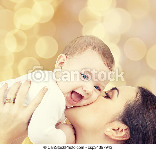 laughing baby playing with mother - csp34397943