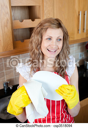 Laughing blond woman drying dishes  - csp3518094