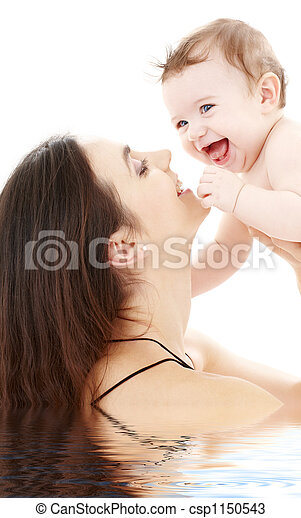 laughing blue-eyed baby playing with mom - csp1150543