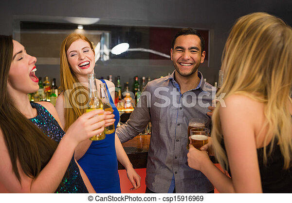 Laughing friends drinking beers - csp15916969