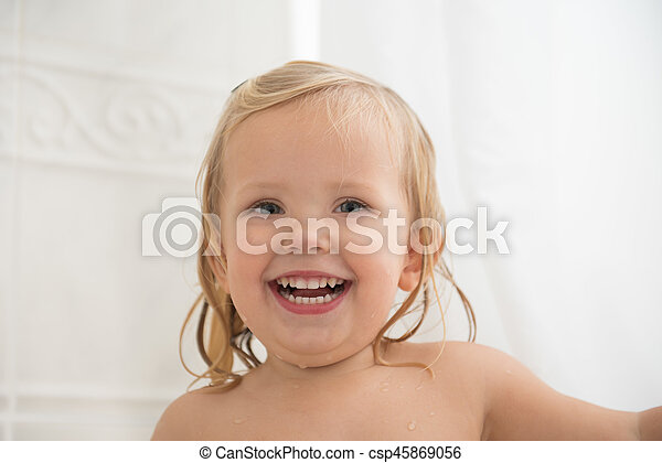 Laughing girl with nice teeth - csp45869056