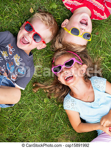 Laughing kids relaxing during summer day - csp15891992