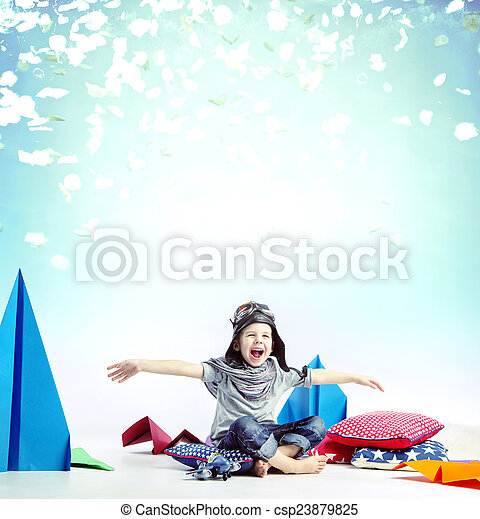 Laughing little boy playing plane toy - csp23879825