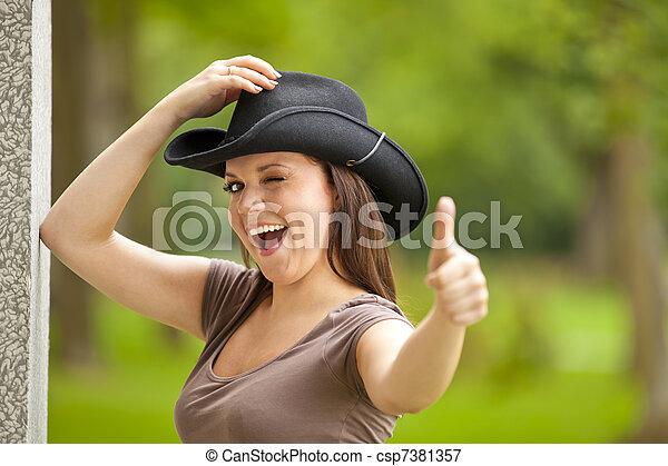 laughing woman posing thumbs up - csp7381357