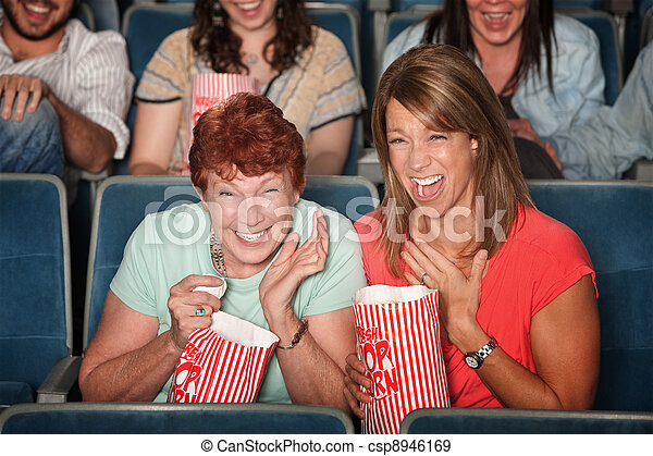 Laughing Women at Picture Show - csp8946169
