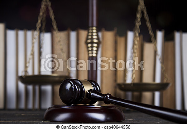Law book, mallet of the judge, justice scale, wooden desk background - csp40644356