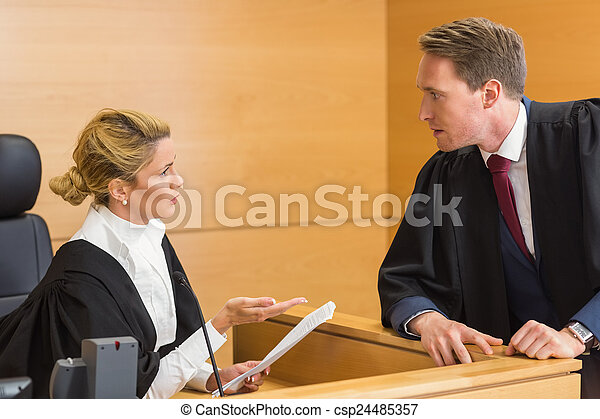 Lawyer speaking with the judge - csp24485357