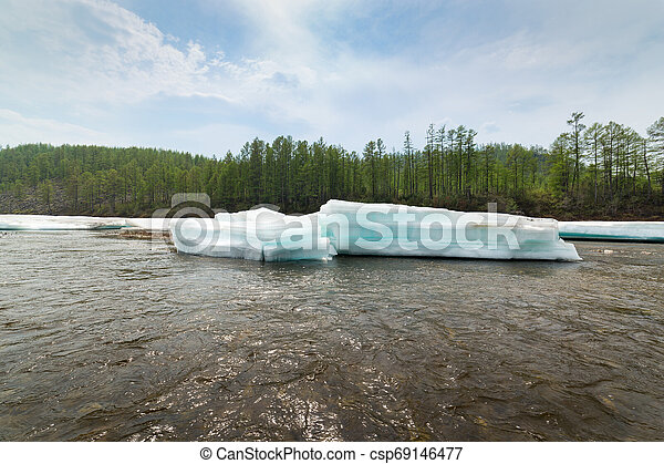 Layered turquoise ice floes on the river - csp69146477