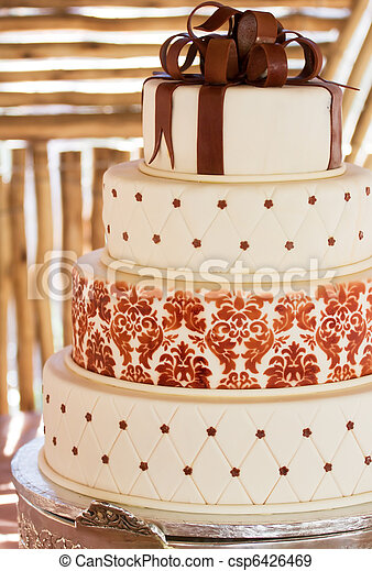 Layered white wedding cake with chocolate detail - csp6426469