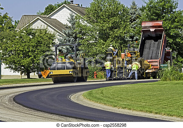 Laying new pavement in a residential neighborhood - csp2558298