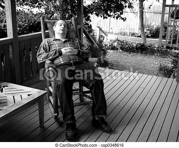 Lazy Afternoon Man Napping In A Rocking Chair On Front