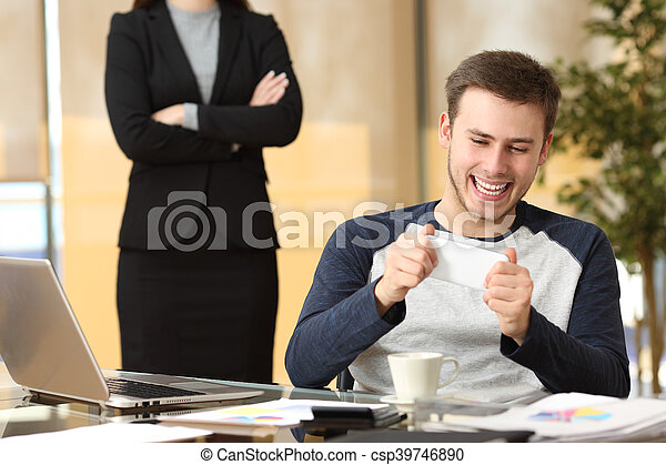 Lazy employee with his angry boss watching - csp39746890