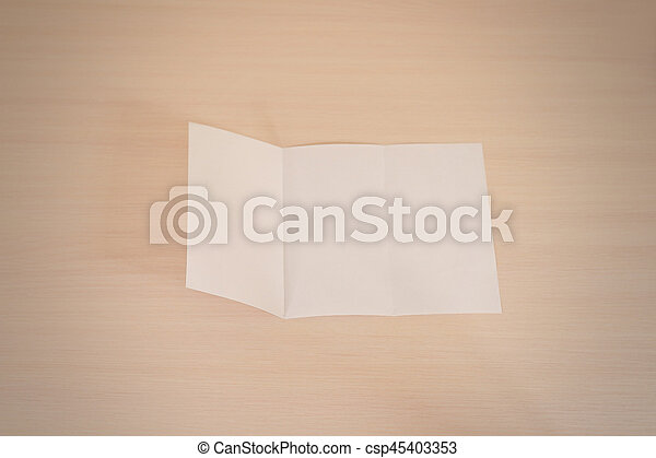 leaflet blank tri fold white paper brochure mockup on a wooden table