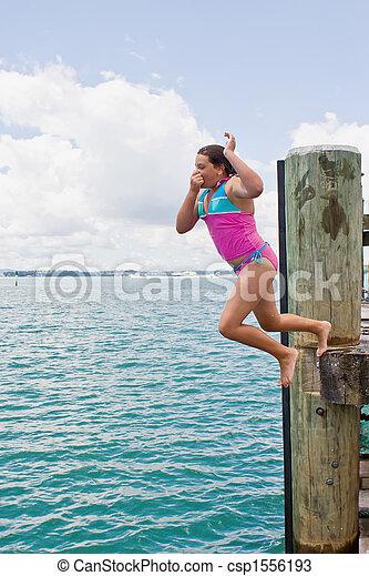 Leap off wharf - csp1556193