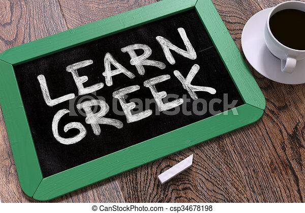 learn greek handwritten by white chalk on a blackboard composition