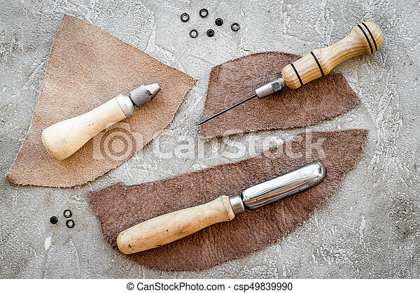 Leather Craft Tools On Grey Stone Background Top View
