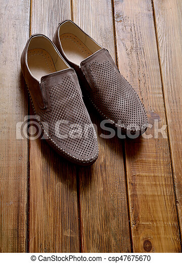 Leather men's shoes with perforation on the wooden background. - csp47675670