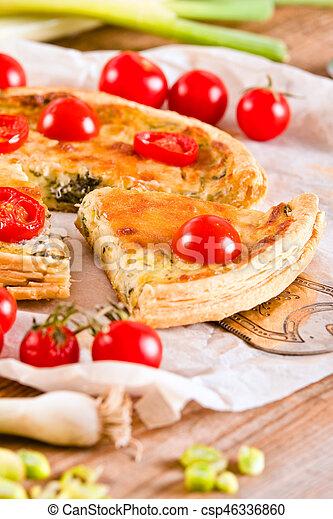 Leek and tomato quiche. - csp46336860