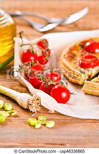 Leek and tomato quiche. - csp46336865