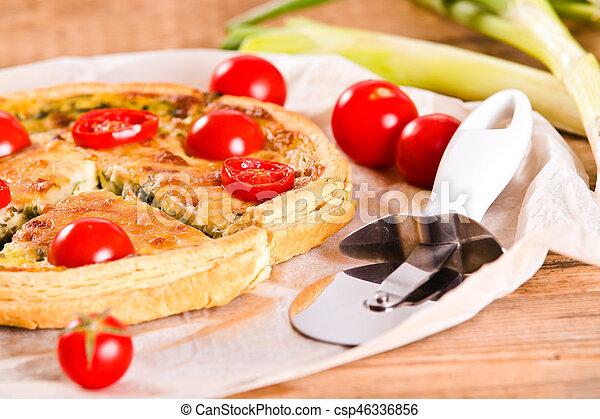 Leek and tomato quiche. - csp46336856