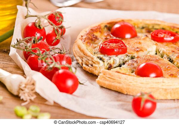 Leek and tomato quiche. - csp40694127