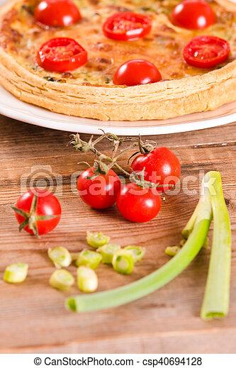 Leek and tomato quiche. - csp40694128